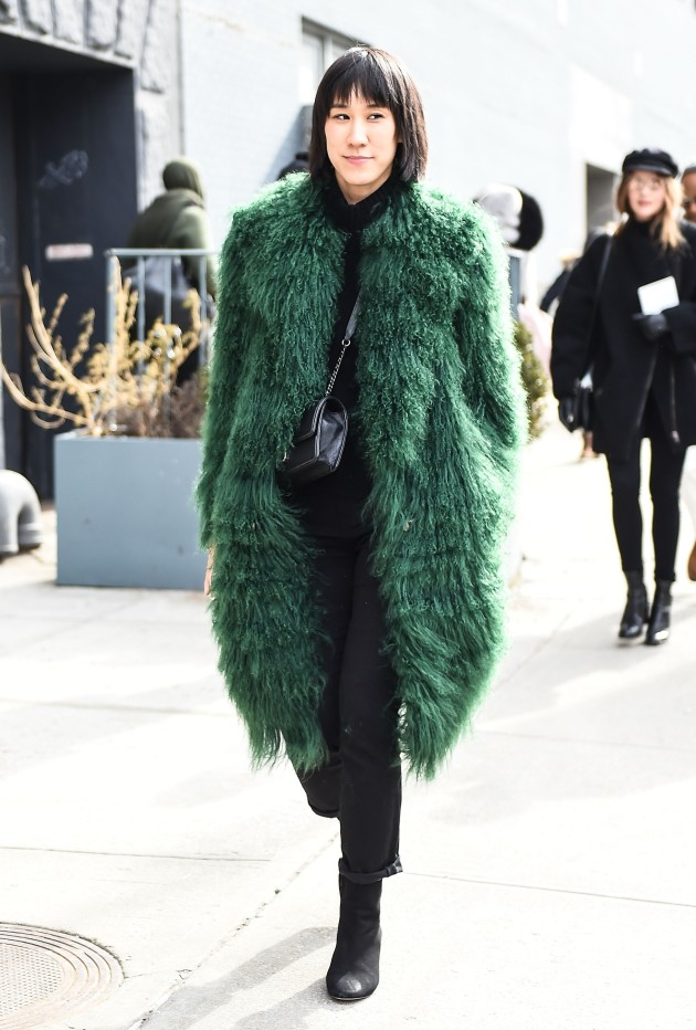 NEW YORK, NY - FEBRUARY 12:  Eva Chen is seen outside the Jason Wu show wearing a Saks Potts green fur coat during New York Fashion Week: Women's Fall/Winter 2016 on February 12, 2016 in New York City.  (Photo by Daniel Zuchnik/Getty Images)